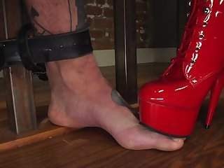 Fierce Cherry Torn incorporates pain in a rough BDSM slave training session