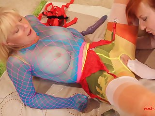 Red XXX and her girlfriend fuck while wearing nylons